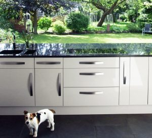 Garden Annex, Nottinghamshire. Kitchen view out to garden through bi-folding doors